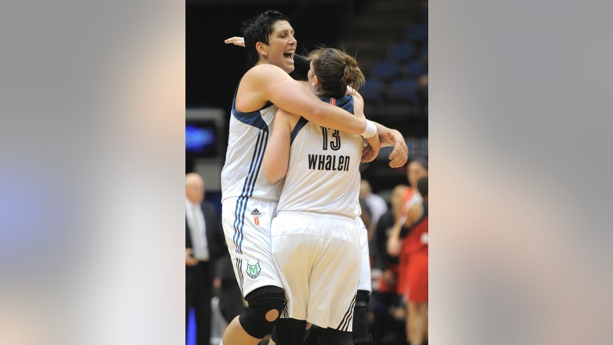 Minnesota Lynx center Janel McCarville, left, gives guard Lindsey Whalen, right, a hug during a timeout in the fourth quarter against the Washington Mystics in a WNBA basketball game Friday, June 20, 2014, in Minneapolis. Minnesota won 75-65.(AP Photo/Tom Olmscheid)