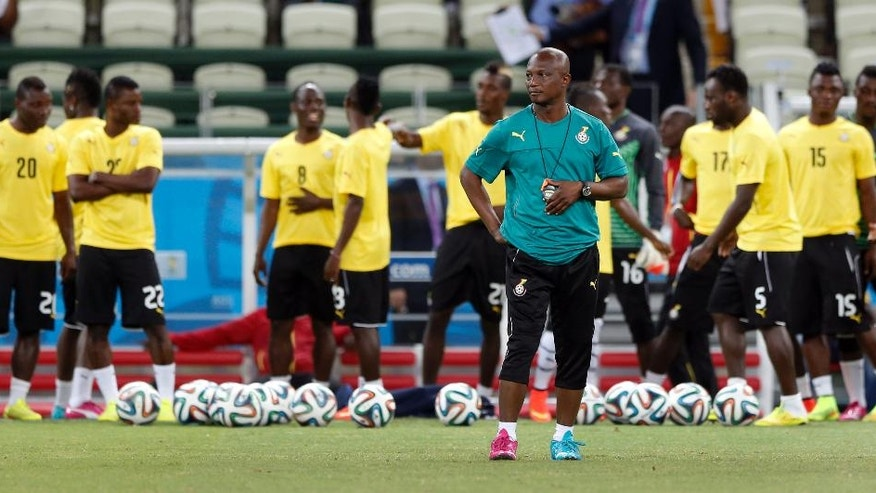 Ghana's head coach Akwasi Appiah arrives for an official training session the day before the group G World Cup soccer match between Germany and Ghana at the Arena Castelao in Fortaleza, Brazil, Friday, June 20, 2014. (AP Photo/Matthias Schrader)