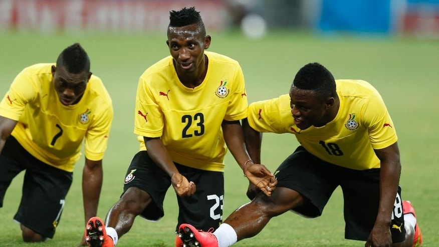 Ghana's Christian Atsu, from left, Harrison Afful and Majeed Waris warm up during an official training session the day before the group G World Cup soccer match between Germany and Ghana at the Arena Castelao in Fortaleza, Brazil, Friday, June 20, 2014. (AP Photo/Matthias Schrader)