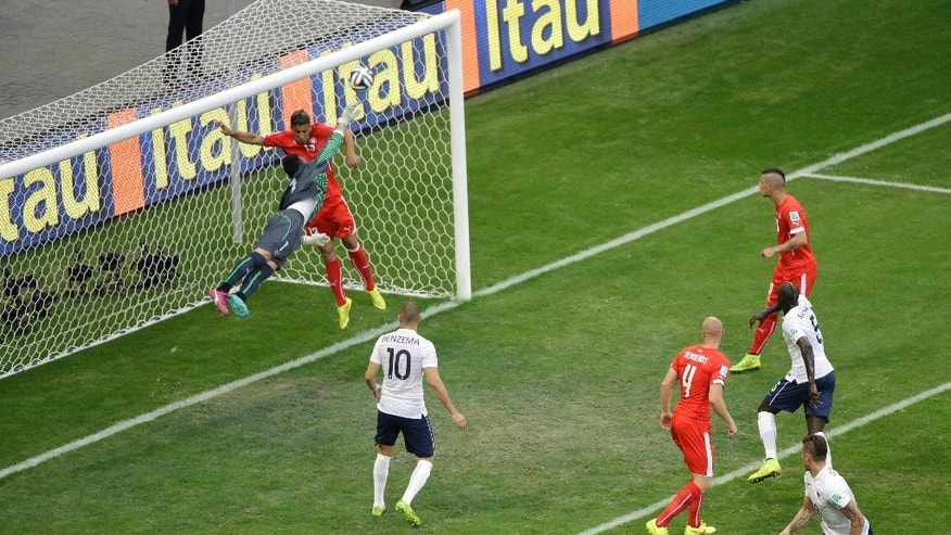 France's Olivier Giroud, bottom right, scores the opening goal during the group E World Cup soccer match between Switzerland and France at the Arena Fonte Nova in Salvador, Brazil, Friday, June 20, 2014. (AP Photo/Sergei Grits)