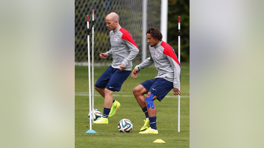 United States' Michael Bradley, left, and Jermaine Jones work out during a training session in Sao Paulo, Brazil, Friday, June 20, 2014. The U.S. will play against Portugal in group G of the 2014 soccer World Cup on June 22. (AP Photo/Julio Cortez)