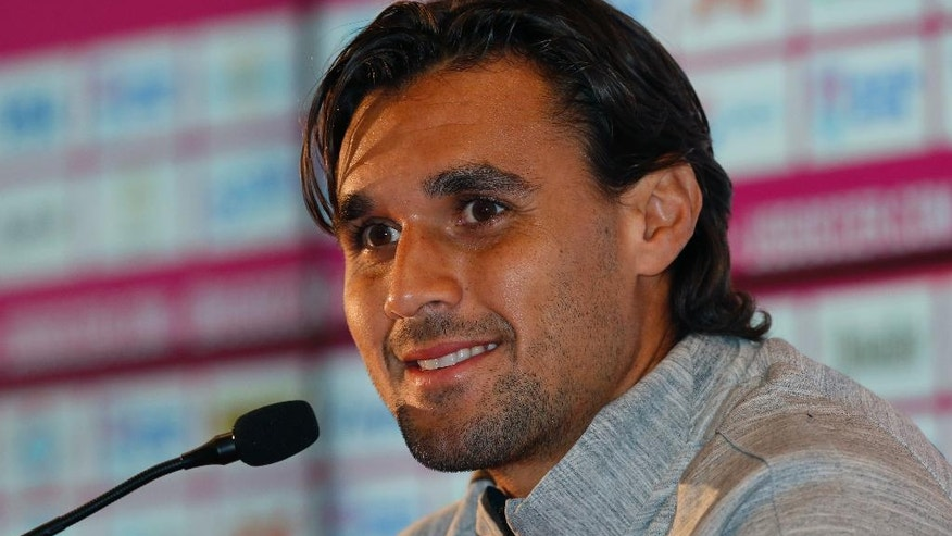 United States' Chris Wondolowski talks during a press conference before a training session in Sao Paulo, Brazil, Friday, June 20, 2014. The U.S. will play against Portugal in group G of the 2014 soccer World Cup on June 22. (AP Photo/Julio Cortez)