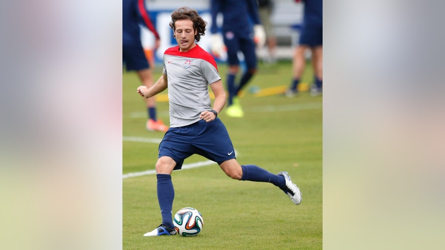 United States' Mix Diskerud kicks a ball during a training session in Sao Paulo, Brazil, Thursday, June 19, 2014.  The United States will play against Portugal in group G of the 2014 soccer World Cup on June 22. (AP Photo/Julio Cortez)