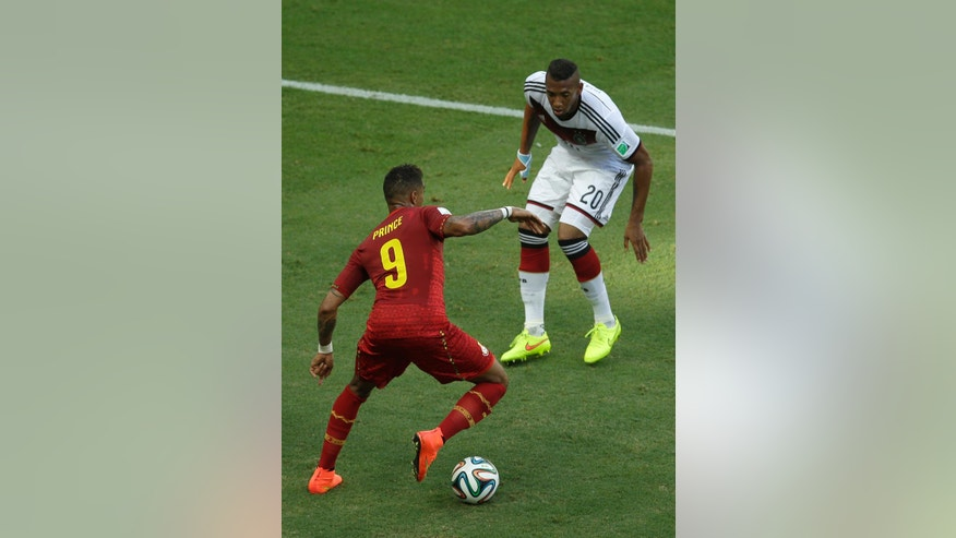 Germany's Jerome Boateng, righ, and his half-borther Ghana's Kevin-Prince Boateng challenge for the ball during the group G World Cup soccer match between Germany and Ghana at the Arena Castelao in Fortaleza, Brazil, Saturday, June 21, 2014. (AP Photo/Themba Hadebe)