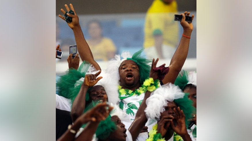 A Nigerian fan cheers before the group F World Cup soccer match between Nigeria and Bosnia at the Arena Pantanal in Cuiaba, Brazil, Saturday, June 21, 2014. (AP Photo/Thanassis Stavrakis)