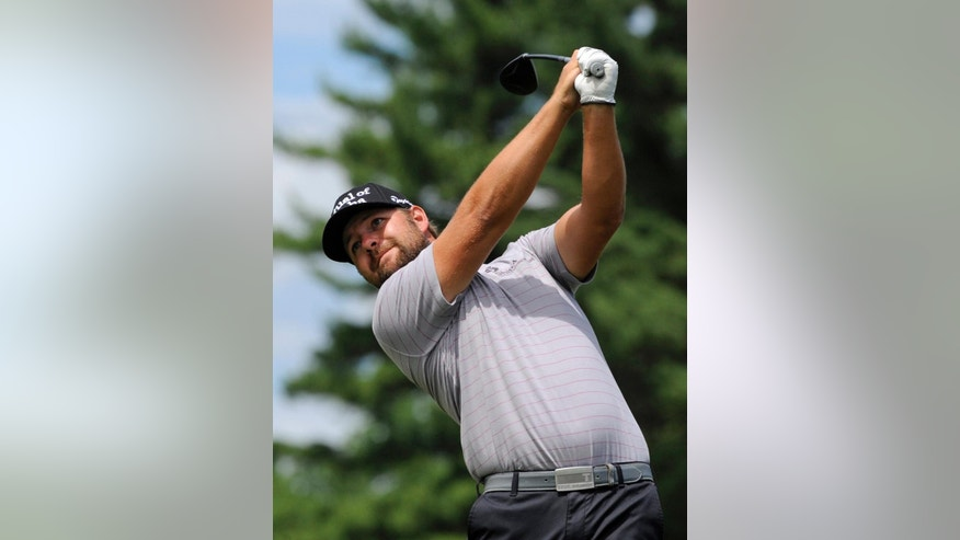 Ryan Moore watches his drive on the second hole during the third round of the Travelers Championship golf tournament in Cromwell, Conn., Saturday, June 21, 2014. (AP Photo/Fred Beckham)