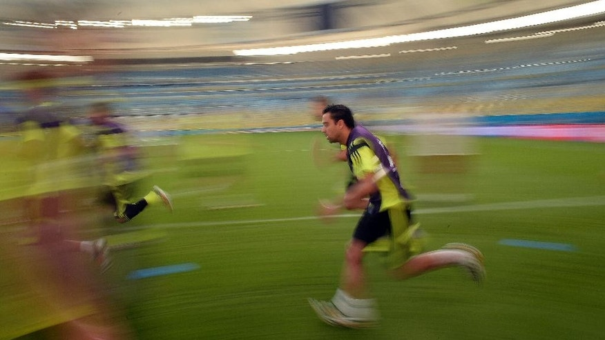 Spain's Xavi Hernandez attends a training session at the Maracana stadium in Rio de Janeiro, Brazil, Tuesday, June 17, 2014. Spain will play in group B of the Brazil 2014 World Cup. (AP Photo/Manu Fernandez)