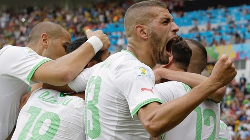 June 22, 2014: Algeria's Islam Slimani, who scored his side's first goal, celebrates with teammates after Algeria's Rafik Halliche scored the side's second goal during the group H World Cup soccer match between South Korea and Algeria at the Estadio Beira-Rio in Porto Alegre, Brazil.