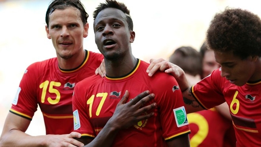 June 22, 2014: Belgium's Divock Origi, centre, celebrates with Belgium's Daniel Van Buyten, left, and Belgium's Axel Witsel, right, after Origi scored the opening goal during the group H World Cup soccer match between Belgium and Russia at the Maracana stadium in Rio de Janeiro, Brazil.