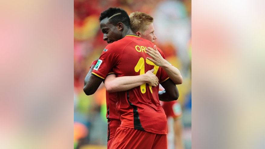Belgium's Divock Origi embraces Belgium's Kevin De Bruyne after the group H World Cup soccer match between Belgium and Russia at the Maracana Stadium in Rio de Janeiro, Brazil, Sunday, June 22, 2014. Belgium won the match 1-0. (AP Photo/Ivan Sekretarev)