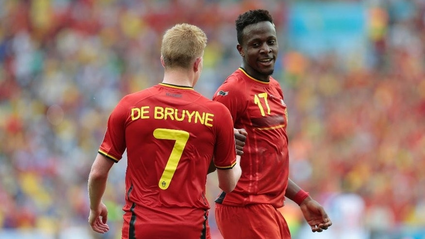 Belgium's Divock Origi, right, greets Belgium's Kevin De Bruyne after Origi scored the opening goal in the group H World Cup soccer match between Belgium and Russia at the Maracana Stadium in Rio de Janeiro, Brazil, Sunday, June 22, 2014. Belgium won the match 1-0. (AP Photo/Ivan Sekretarev)