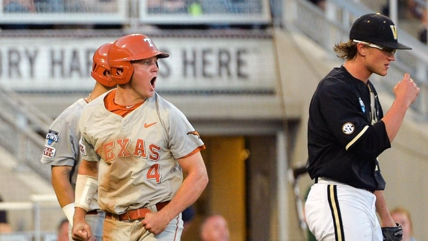 Texas' Collin Shaw (4) celebrates after he scored on a two-run single hit by Kacy Clemens in the fourth inning of an NCAA baseball College World Series game against Vanderbilt in Omaha, Neb., Saturday, June 21, 2014. Vanderbilt pitcher Carson Fulmer, right, looks on. (AP Photo/Ted Kirk)