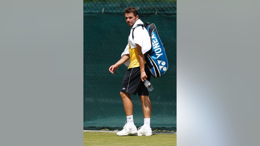 Stan Wawrinka of Switzerland arrives for a practice session ahead of the All England Lawn Tennis Championships in Wimbledon, London, Sunday June 22, 2014. The Championships start on Monday June 23. (AP Photo/Sang Tan)