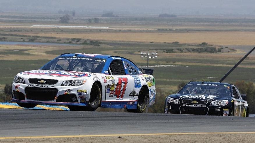 AJ Allmendinger (47) leads Jamie McMurray during the NASCAR Sprint Cup Series auto race on Sunday, June 22, 2014, in Sonoma, Calif. (AP Photo/Eric Risberg)