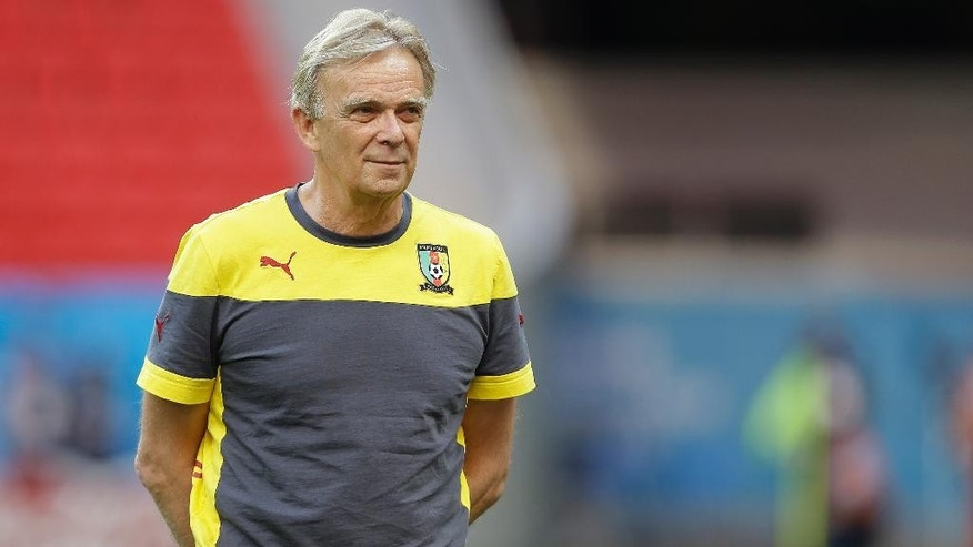 Cameroon's head coach Volker Finke looks at his team during an official training session the day before the group A World Cup soccer match between Brazil and Cameroon at the Estadio Nacional in Brasilia, Sunday, June 22, 2014. Cameroon began the tournament with a 1-0 loss to Mexico and a 4-0 defeat to Croatia and they will want to leave the World Cup by beating the hosts. (AP Photo/Andre Penner)