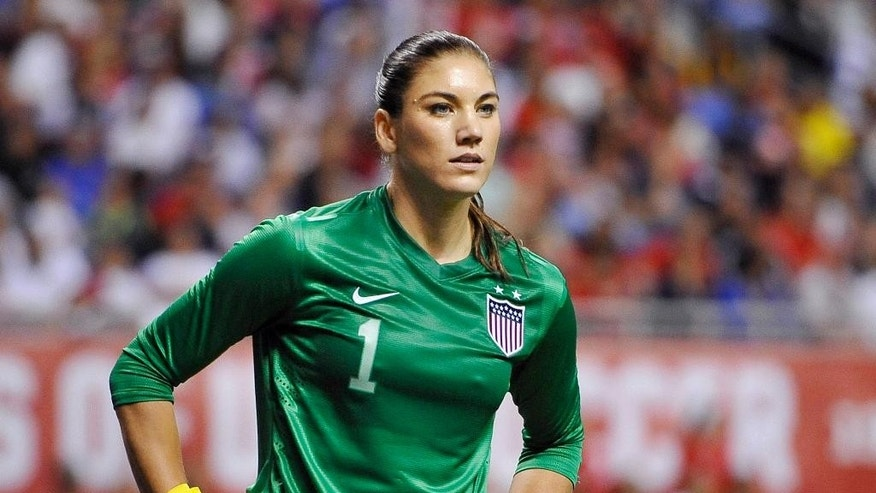 Oct. 20, 2013: In this file photo, U.S. goalkeeper Hope Solo pauses on the field during the second half of an international friendly women's soccer match against Australia in San Antonio.