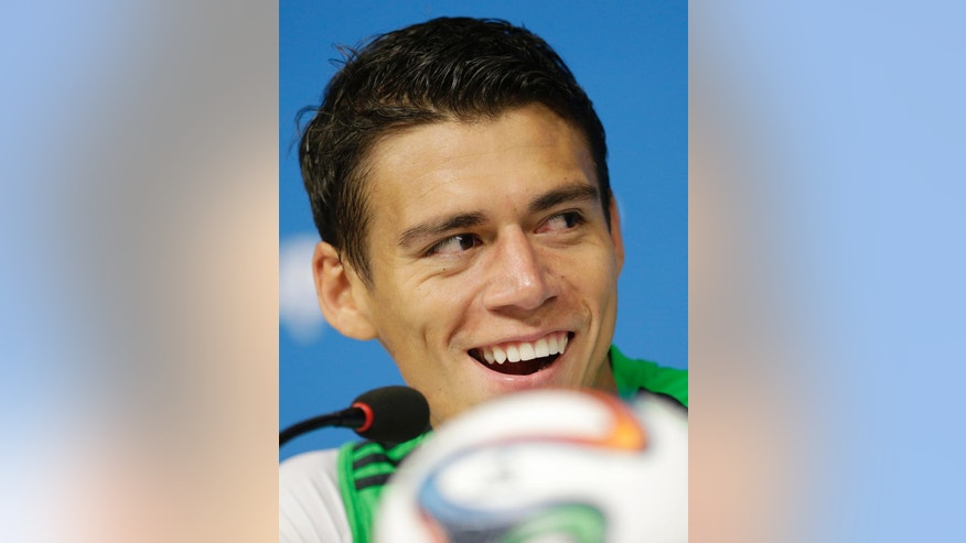 Hector Moreno of Mexico smiles during a press conference at the Arena Pernambuco in Recife, Brazil, Sunday, June 22, 2014. Mexico will play Croatia in a group A match of the 2014 soccer World Cup. (AP Photo/Petr David Josek)