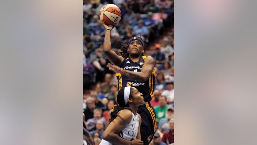 Indiana Fever guard Sydney Carter, top, shoots over Minnesota Lynx forward Maya Moore, below, during the second quarter of a WNBA basketball game Sunday, June 22, 2014, in Minneapolis. (AP Photo/Tom Olmscheid)