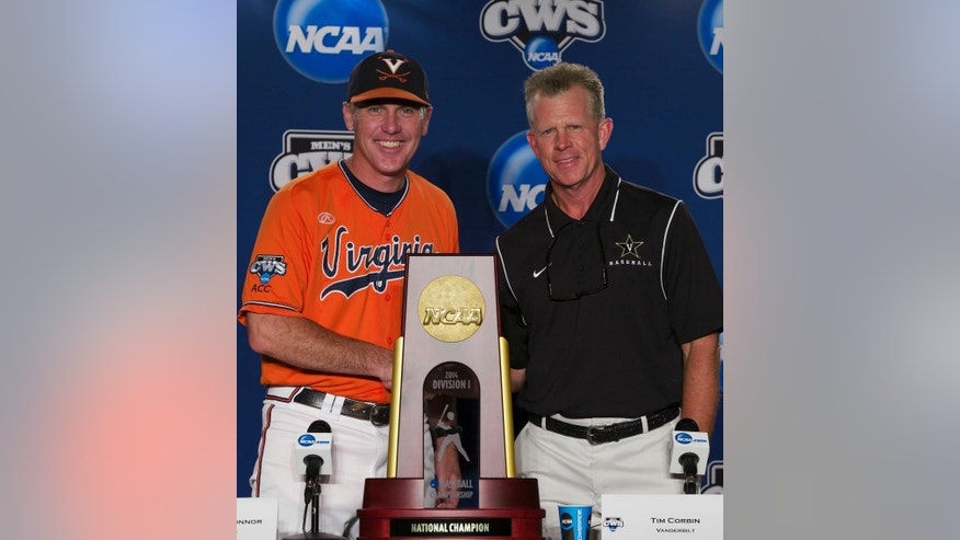 Virginia coach Brian O'Connor, left, and Vanderbilt coach Tim Corbin pose with the College World Series trophy prior to a news conference on Sunday, June 22, 2014, ahead of the NCAA baseball College World Series finals between the teams which begin on Monday at TD Ameritrade Park in Omaha, Neb. (AP Photo/Nati Harnik)