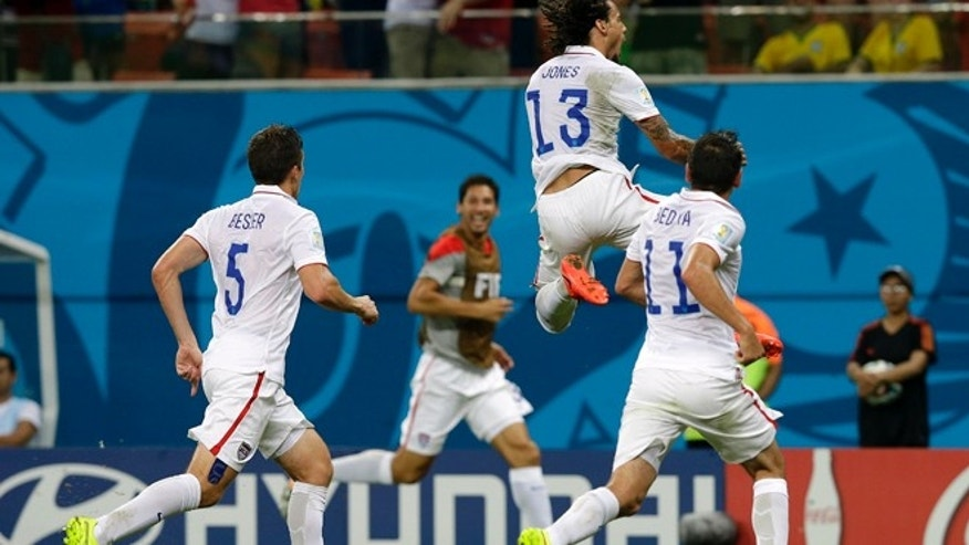 June 22, 2014: United States' Jermaine Jones (13) celebrates after scoring his side's first goal during the group G World Cup soccer match between the United States and Portugal at the Arena da Amazonia in Manaus, Brazil.