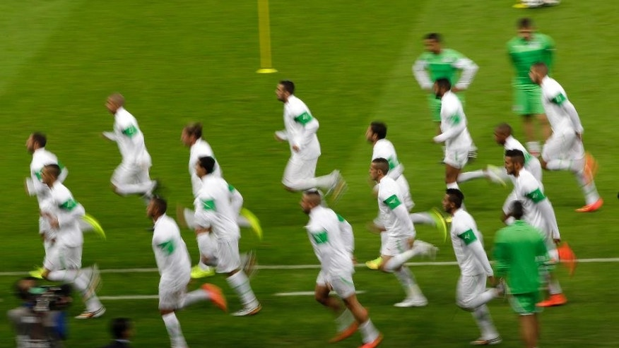 Algeria national soccer team players warm up during an official training session the day before the group H World Cup soccer match between South Korea and Algeria at the Estadio Beira-Rio in Porto Alegre, Brazil, Saturday, June 21, 2014.  (AP Photo/Lee Jin-man)