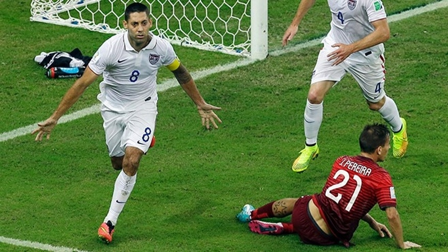 United States' Clint Dempsey, left, celebrates scoring his side's second goal during the group G World Cup soccer match between the USA and Portugal at the Arena da Amazonia in Manaus, Brazil, Sunday, June 22, 2014. (AP Photo/Themba Hadebe)