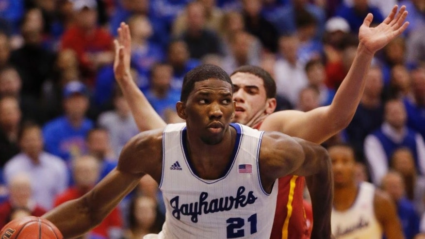 FILE - In this Jan. 29, 2014 file photo, Kansas center Joel Embiid (21) works around Iowa State forward Georges Niang, back, during the first half of an NCAA college basketball game in Lawrence, Kan. Embiid's hope of being the No. 1 pick in the 2014 NBA Draft is almost certainly gone now because of his foot injury.(AP Photo/Orlin Wagner, File)