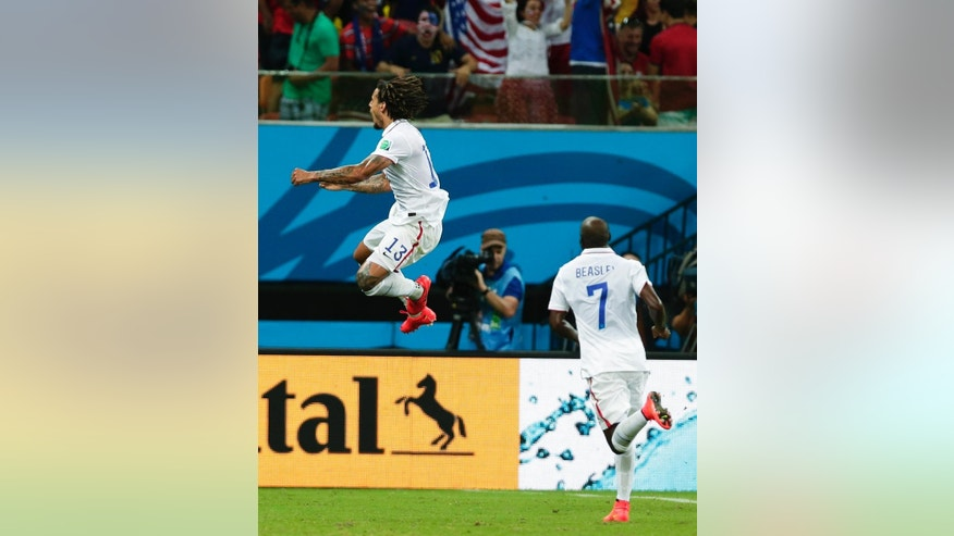 United States' Jermaine Jones, left, celebrates with United States' DaMarcus Beasley, right, after Jones scored his side's first goal during the group G World Cup soccer match between the United States and Portugal at the Arena da Amazonia in Manaus, Brazil, Sunday, June 22, 2014. (AP Photo/Marcio Jose Sanchez)