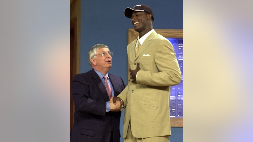 FILE - In this June 27, 2001 file photo, NBA Commissioner David Stern, left, congratulates Glynn Academy's Kwame Brown after being chosen as the No. 1 overall draft pick by the Washington Wizards during the 2001 NBA Draft in New York. For every Hall of Fame-level big man like Shaquille O'Neal, David Robinson, Tim Duncan and Hakeem Olajuwon, there's a Pervis Ellison, Michael Olowokandi, Kwame Brown and Greg Oden to serve as a cautionary tale.(AP Photo/Ron Frehm, File)