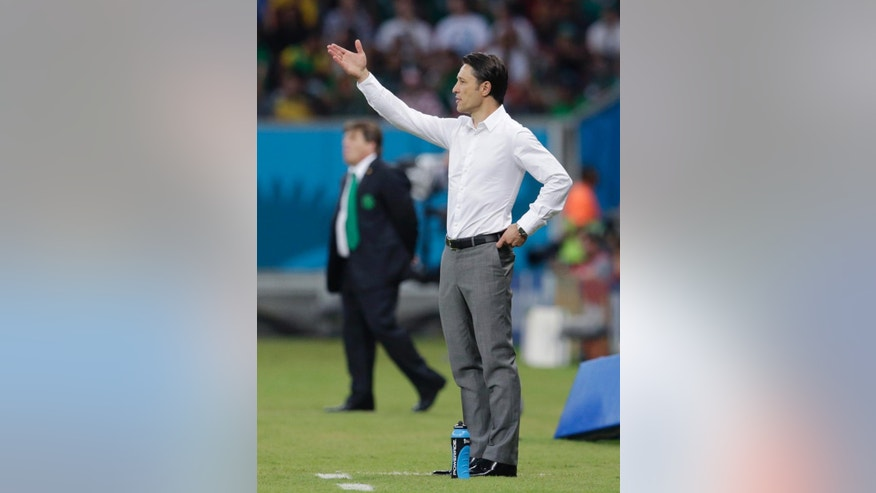Croatia's coach Niko Kovac gestures during the group A World Cup soccer match between Croatia and Mexico at the Arena Pernambuco in Recife, Brazil, Monday, June 23, 2014. (AP Photo/Petr David Josek)