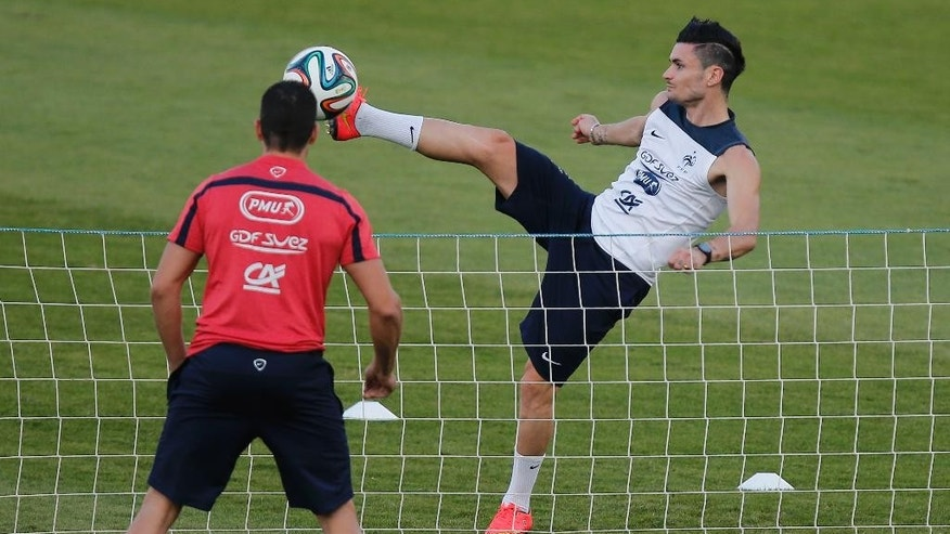 France's Remy Cabella plays tennis-ball during a training session at the Santa Cruz stadium in Ribeirao Preto, Brazil, Sunday, June 22, 2014. Having captured people's attention at the soccer World Cup with some scintillating attacking football, France's players are now in unknown territory after raising expectations back home, having routed Switzerland and Honduras. (AP Photo/David Vincent)