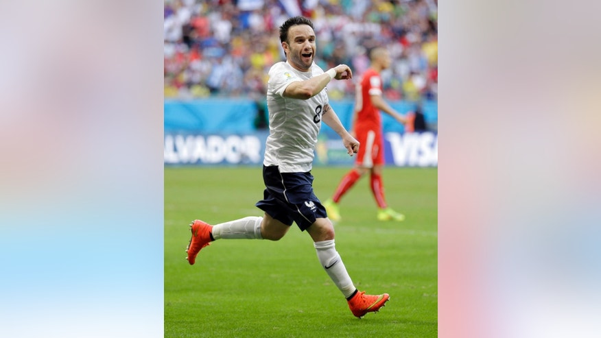 France's Mathieu Valbuena celebrates after scoring his side's third goal during the group E World Cup soccer match between Switzerland and France at the Arena Fonte Nova in Salvador, Brazil, Friday, June 20, 2014. (AP Photo/Natacha Pisarenko)