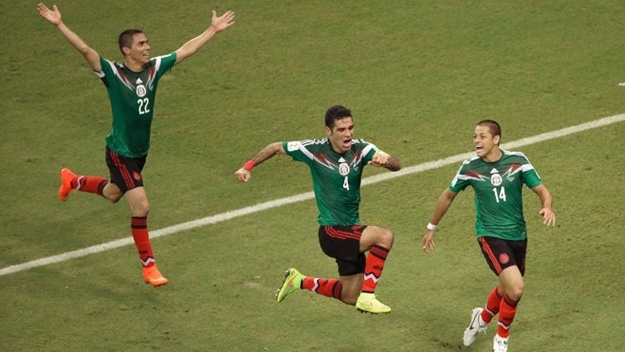 Mexico's Rafael Marquez (4) celebrates scoring his side's first goal during the group A World Cup soccer match between Croatia and Mexico at the Arena Pernambuco in Recife, Brazil, Monday, June 23, 2014.