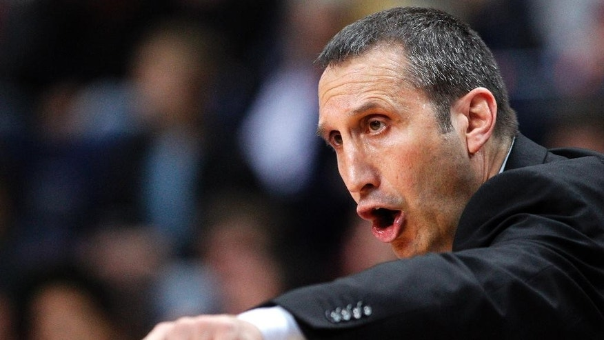 FILE - In this Nov. 7, 2013, file photo, Maccabi Electra Tel Aviv coach  David Blatt gestures to his players during their Euroleague basketball match against Lithuania's BC Lietuvos rytas in Vilnius,  Lithuania. The Cleveland Cavaliers offered the successful European coach its coaching job Thursday night, June 19,2 014, and is discussing a contract with him, said a person who spoke to The Associated Press on condition of anonymity because the team is not commenting.  (AP Photo/Mindaugas Kulbis, File)