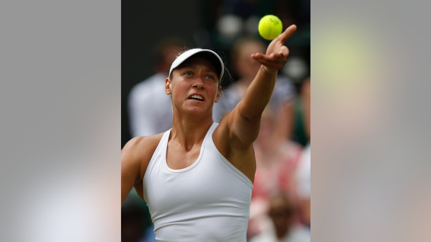 Belgium's Yanina Wickmayer serves to Australia's Samantha Stosur during their first round match at the All England Lawn Tennis Championships in Wimbledon, London,  Monday, June  23, 2014. (AP Photo/Sang Tan)