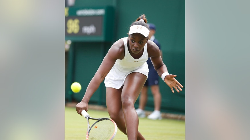 Sloane Stephens of U.S. plays a return to Maria Kirilenko of Russia during their first round match at the All England Lawn Tennis Championships in Wimbledon, London,  Monday, June  23, 2014. (AP Photo/Pavel Golovkin)