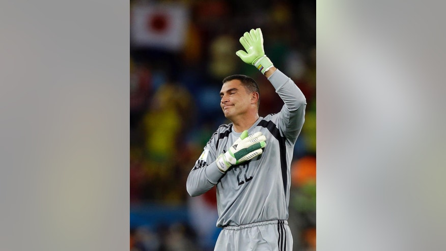 Colombia's goalkeeper Faryd Mondragon, waves to spectators after the group C World Cup soccer match between Japan and Colombia at the Arena Pantanal in Cuiaba, Brazil, Tuesday, June 24, 2014. Colombia won the match 4-1. (AP Photo/Kirsty Wigglesworth)