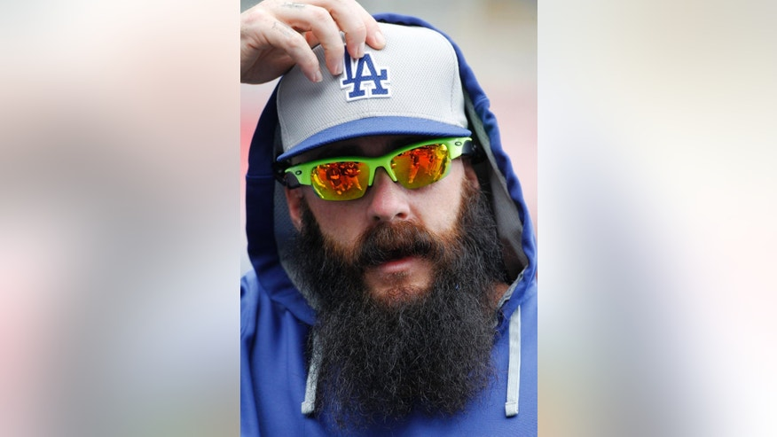 Los Angeles Dodgers pitcher Brian Wilson adjusts his cap before a baseball game against the Kansas City Royals at Kauffman Stadium in Kansas City, Mo., Tuesday, June 24, 2014.  (AP Photo/Colin E. Braley)