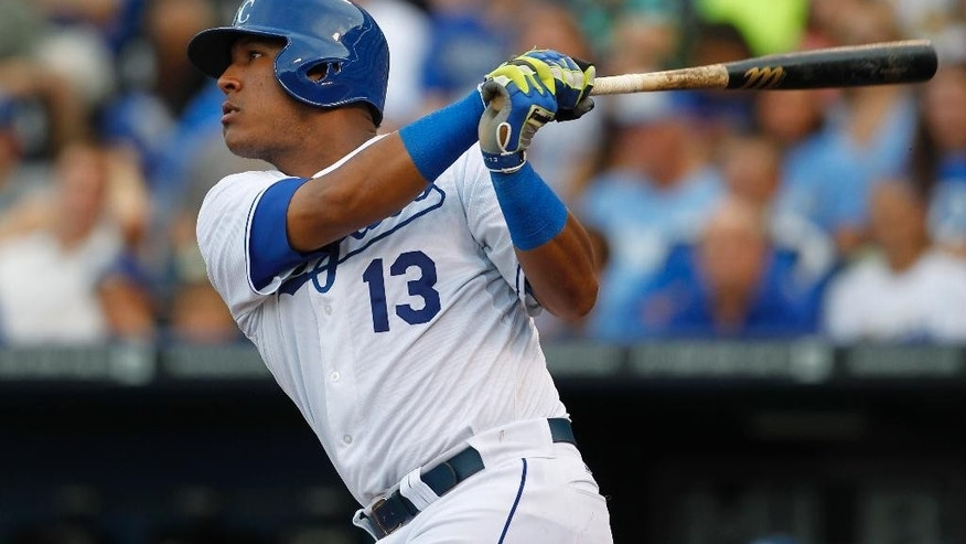 Kansas City Royals' Salvador Perez hits a home run in the second inning of a baseball game against the the Los Angeles Dodgers at Kauffman Stadium in Kansas City, Mo., Monday, June 23, 2014. (AP Photo/Colin E. Braley)