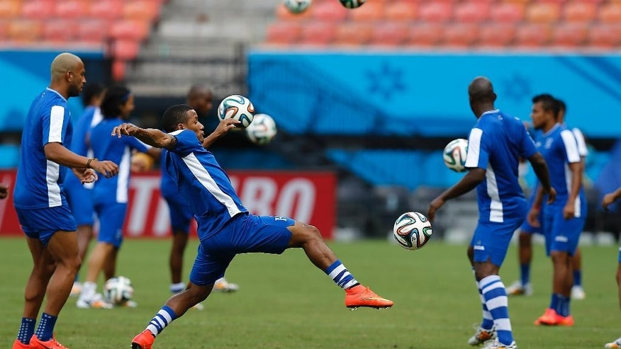 Honduras' players practice during a training session at the Arena da Amazonia in Manaus, Brazil, Tuesday, June 24, 2014, one day before the group E match between Honduras and Switzerland of the 2014 soccer World Cup. (AP Photo/Frank Augstein)