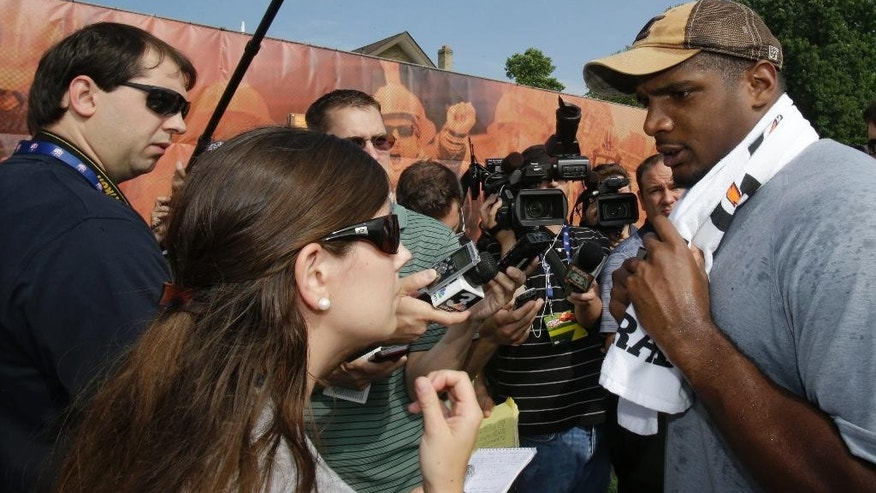 St. Louis Rams NFC rookie Michael Sam talks with the media during an NFL football Play 60 youth event, part of the NFL's annual Rookie Symposium, at the Cleveland Browns practice facility Tuesday, June 24, 2014, in Berea, Ohio.  (AP Photo/Tony Dejak)
