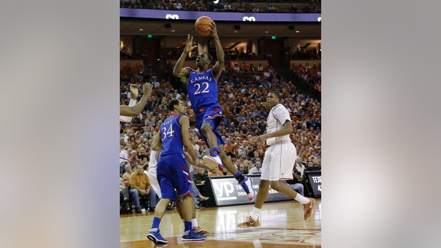 FILE - In this Feb. 1, 2014 file photo, Kansas' Andrew Wiggins (22) drives to the basket against Texas during the second half of an NCAA college basketball game in Austin, Texas. Wiggins is a possible pick in the 2014 NBA Draft, Thursday, June 26, 2014 in New York. (AP Photo/Eric Gay, File)