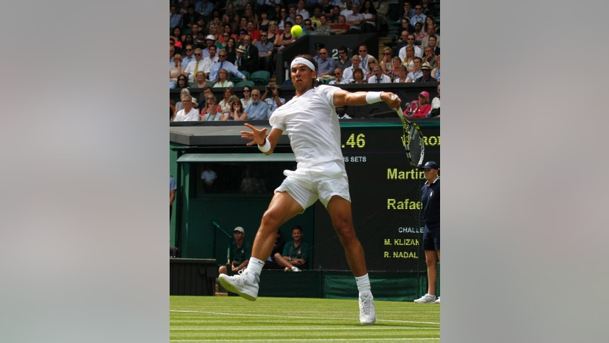Rafael Nadal of Spain plays a return to Martin Klizan of Slovakia match at the All England Lawn Tennis Championships in Wimbledon, London, Tuesday, June 24, 2014. (AP Photo/Sang Tan)