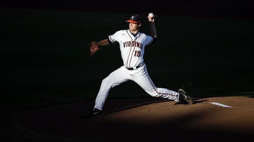 Virginia pitcher Nathan Kirby (19) throws a pitch in the first inning of one of the best-of-three games against Vanderbilt in the NCAA baseball College World Series finals in Omaha, Neb., Monday, June 23, 2014. (AP Photo/Nati Harnik)