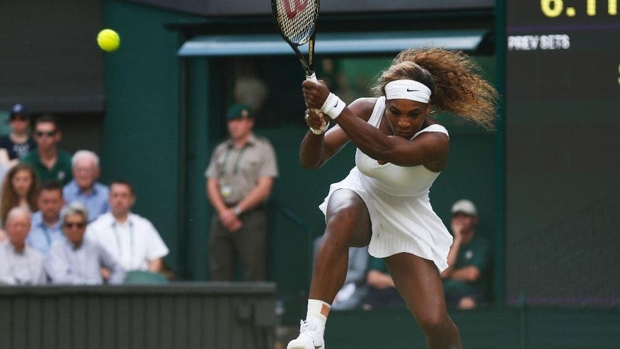 Serena Williams of U.S. plays a return to Anna Tatishvili of U.S. during their first round match at the All England Lawn Tennis Championships in Wimbledon, London, Tuesday, June 24, 2014. (AP Photo/Sang Tan)