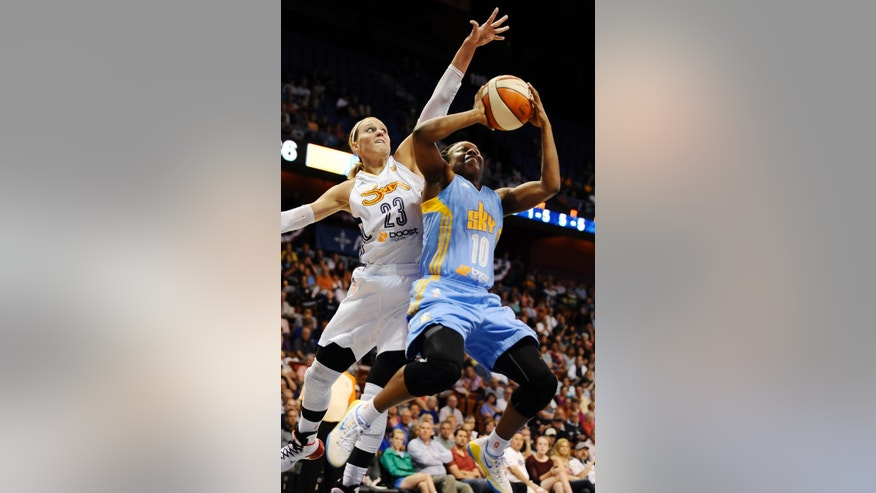 Chicago Sky's Epiphanny Prince shoots as Connecticut Sun's Katie Douglas defends, left, during the first half of a WNBA basketball game, Wednesday, June 25, 2014, in Uncasville, Conn. (AP Photo/Jessica Hill)