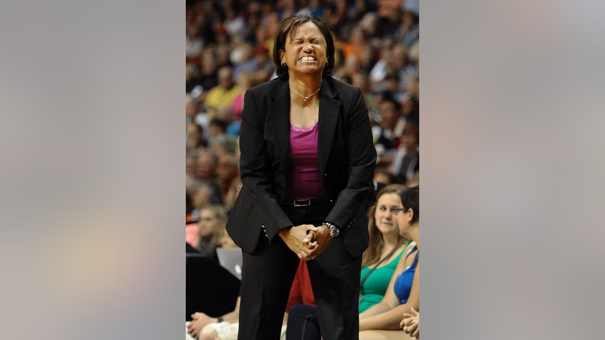 Chicago Sky head coach Pokey Chatman reacts during the first half of a WNBA basketball game against the Connecticut Sun, Wednesday, June 25, 2014, in Uncasville, Conn. (AP Photo/Jessica Hill)