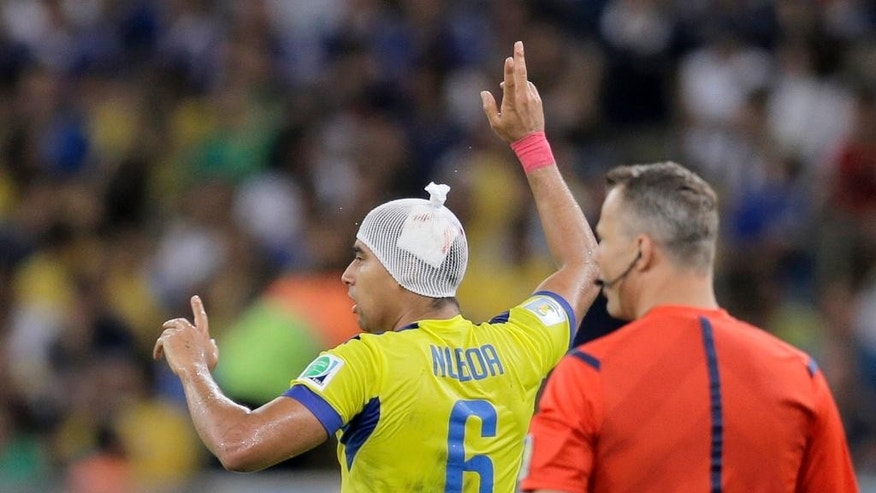 Ecuador's Cristhian Noboa wears a bandage on his head after an injury during the group E World Cup soccer match between Ecuador and France at the Maracana Stadium in Rio de Janeiro, Brazil, Wednesday, June 25, 2014. (AP Photo/Natacha Pisarenko)