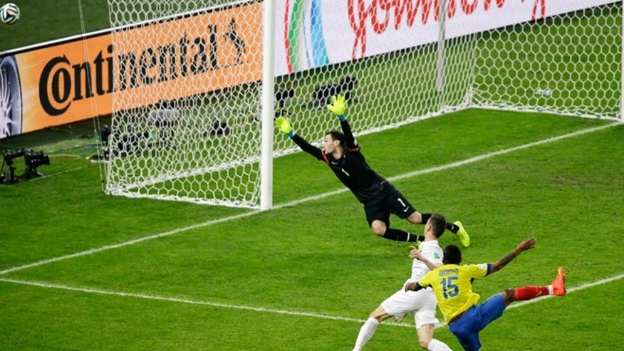 June 25, 2014: Ecuador's Michael Arroyo (15) takes a shot which goes wide past France's goalkeeper Hugo Lloris as France's Laurent Koscielny defends during the group E World Cup soccer match between Ecuador and France at the Maracana Stadium in Rio de Janeiro, Brazil.