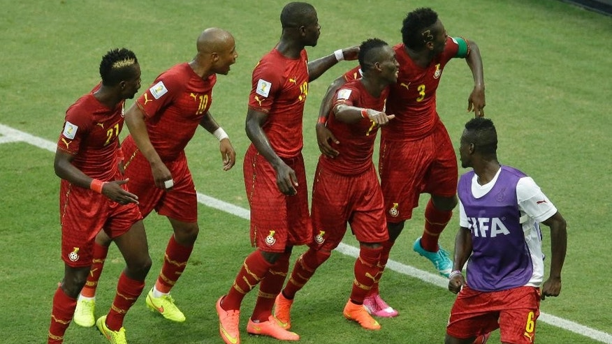Ghana's Asamoah Gyan, second right, dances with his teammates as they celebrate after scoring their second goal during the group G World Cup soccer match between Germany and Ghana at the Arena Castelao in Fortaleza, Brazil, Saturday, June 21, 2014. (AP Photo/Themba Hadebe)